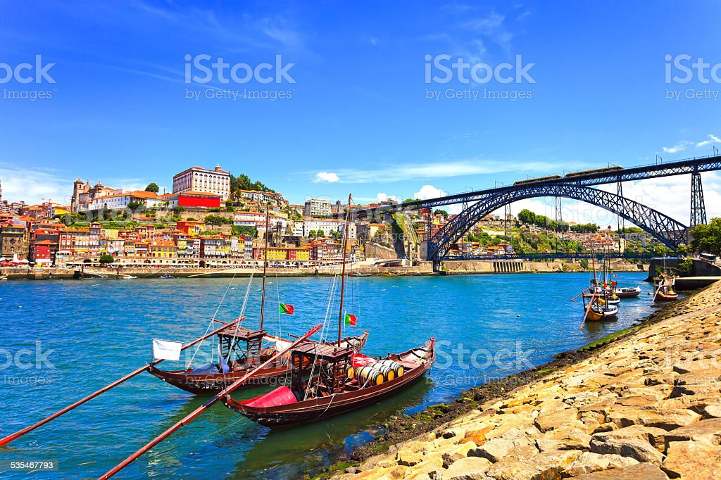 Oporto  Porto skyline, Douro river, boats and iron bridge. Por stock photo
