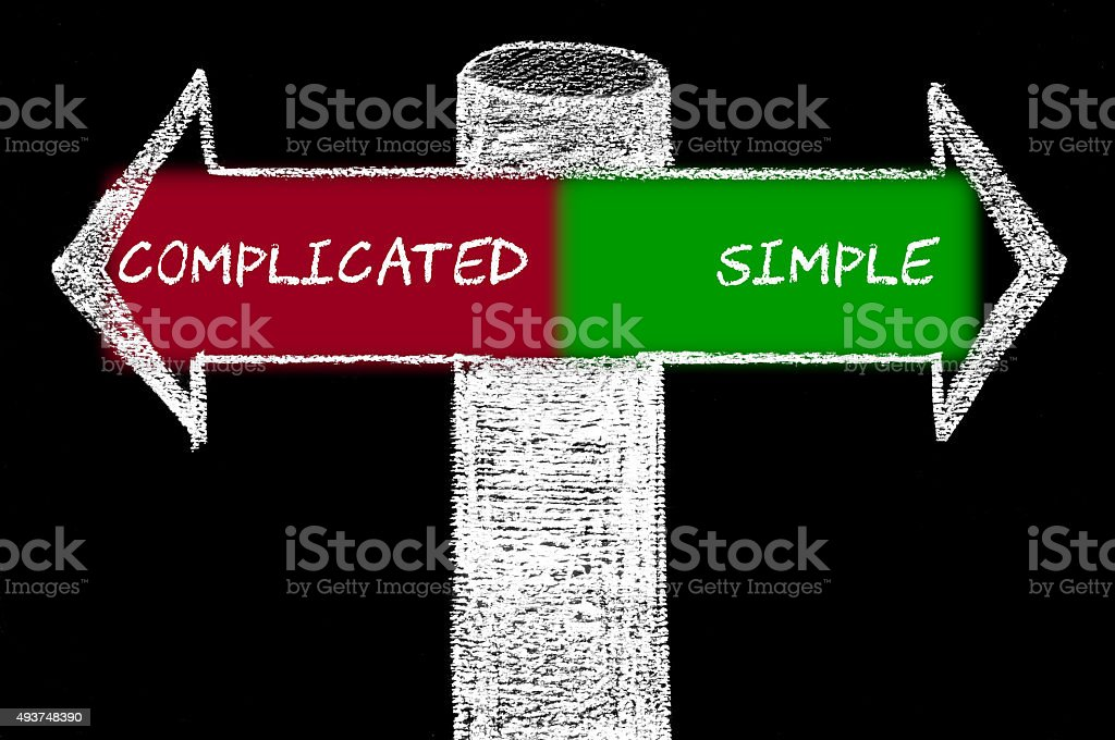 Opposite arrows with Complicated versus Simple stock photo