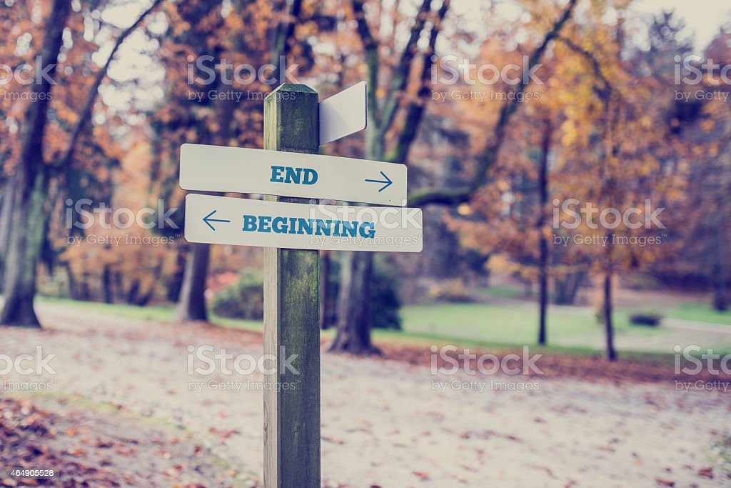 Opposite directions towards End and Beginning stock photo