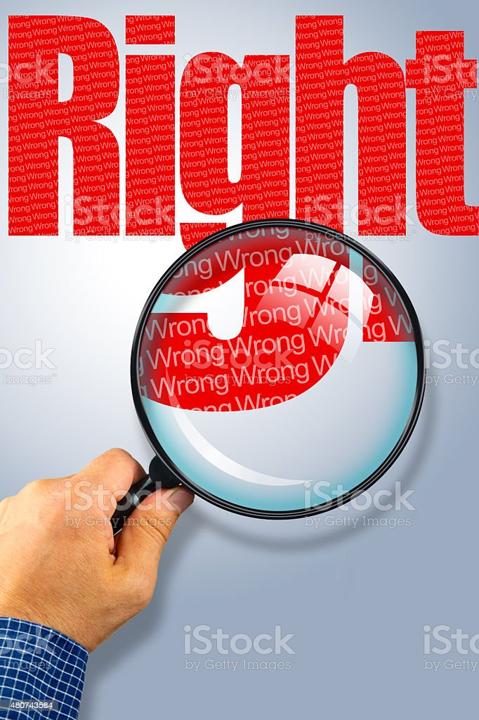 RIGHT - WRONG Opposite message, Hand holding magnifying glass stock photo