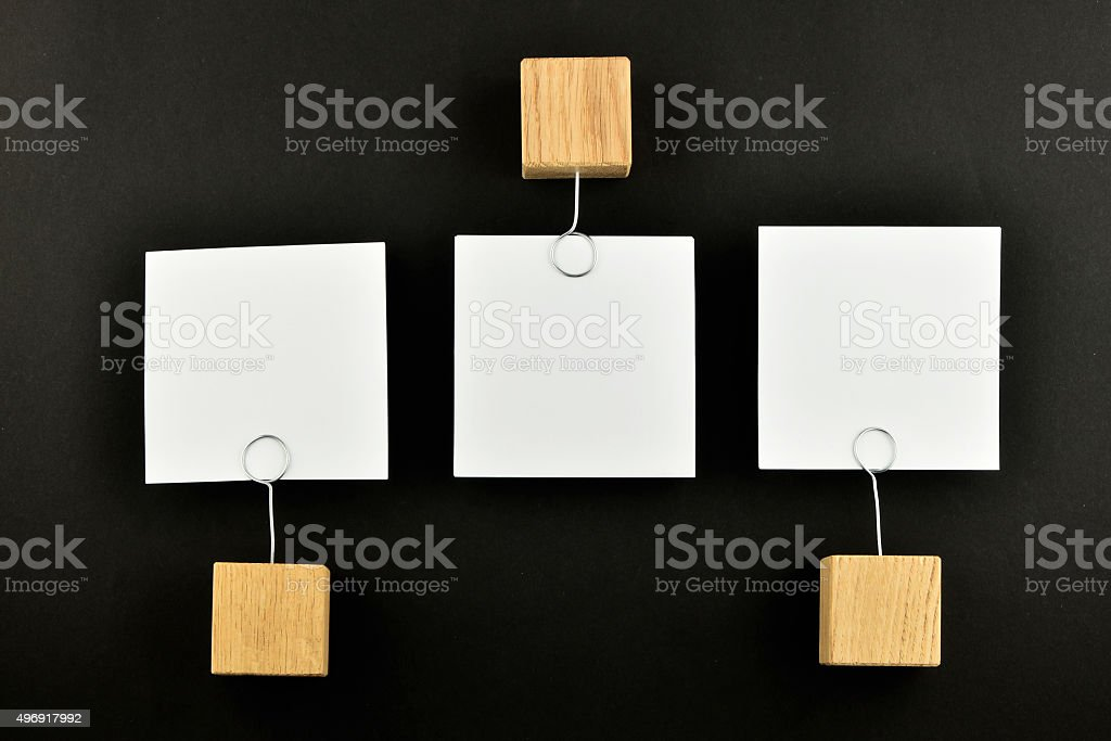 Opposite Opinion, three paper notes on black background for pres royalty-free stock photo
