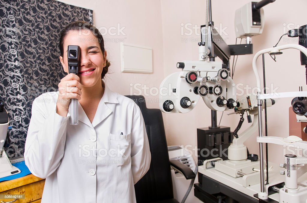Optical store, people and lenses. stock photo