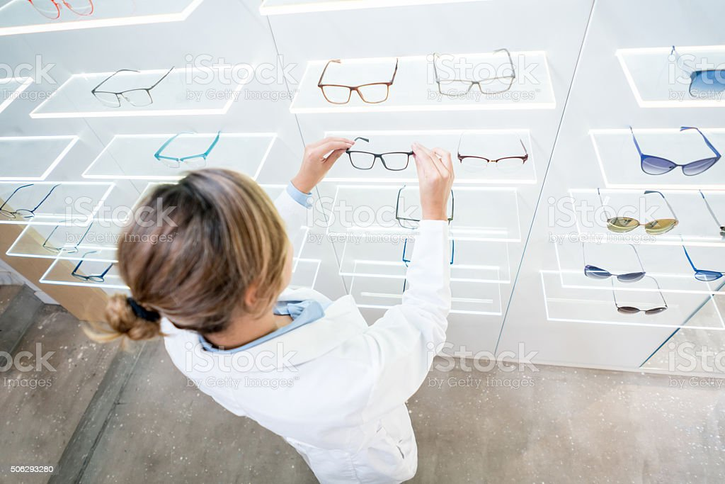 Optician doing inventory at the optics stock photo