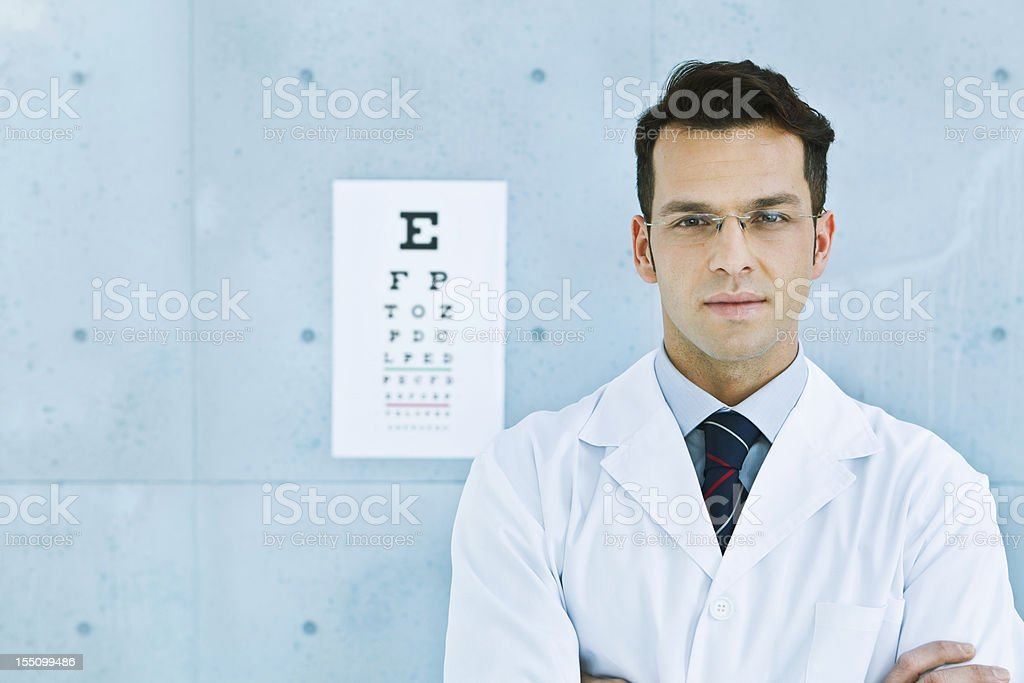 Optician in front of an eye chart stock photo