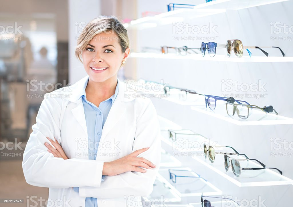 Optician selling glasses at the optics stock photo