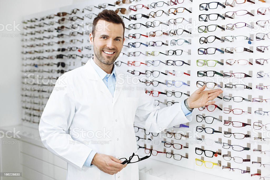Optician selling glasses stock photo
