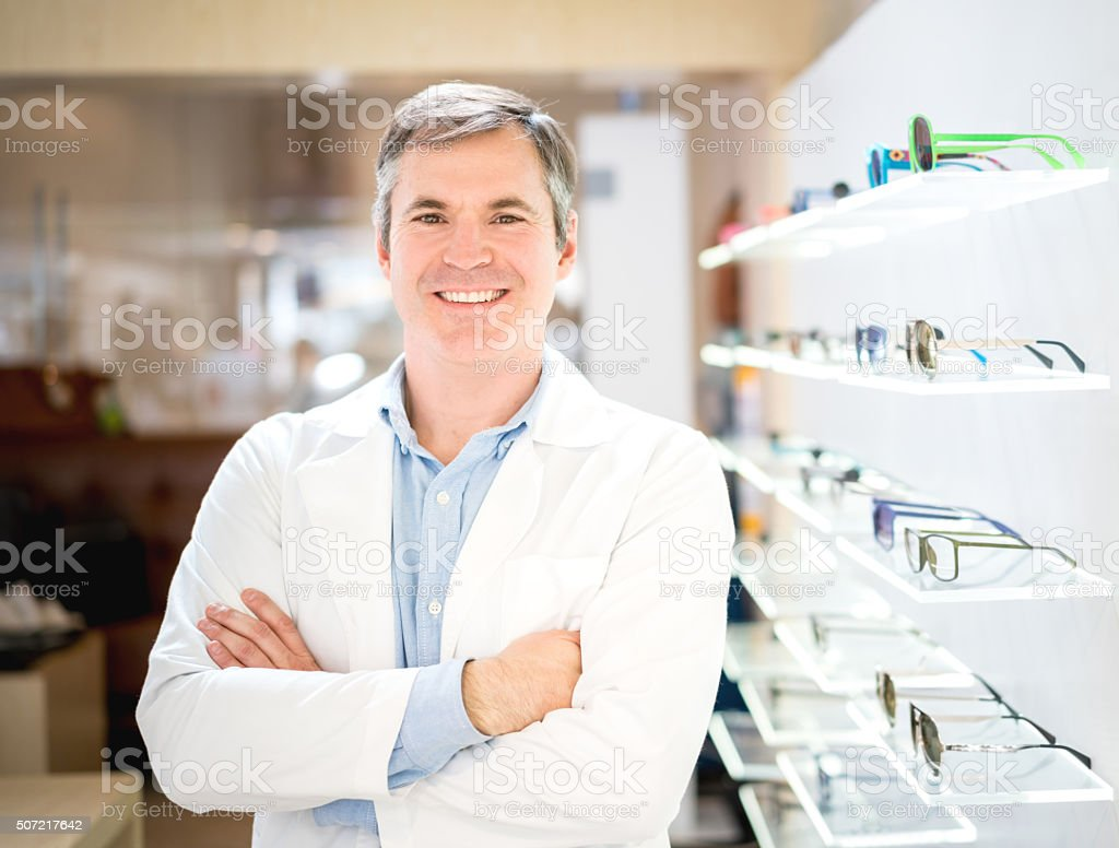 Optician selling glasses stock photo