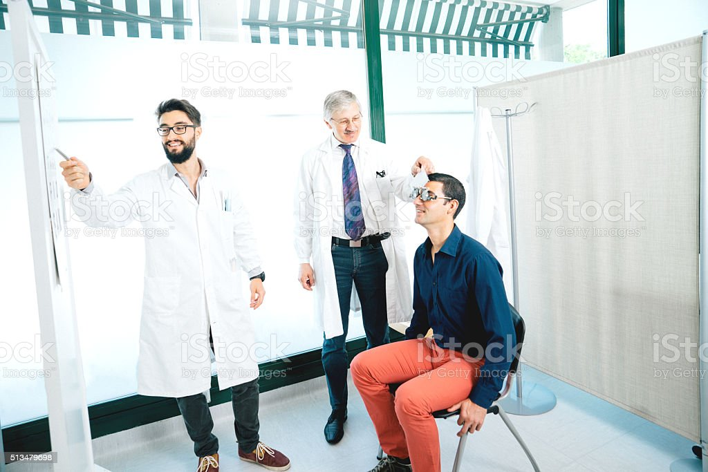 Opticians Making Eye Test To A Patient stock photo