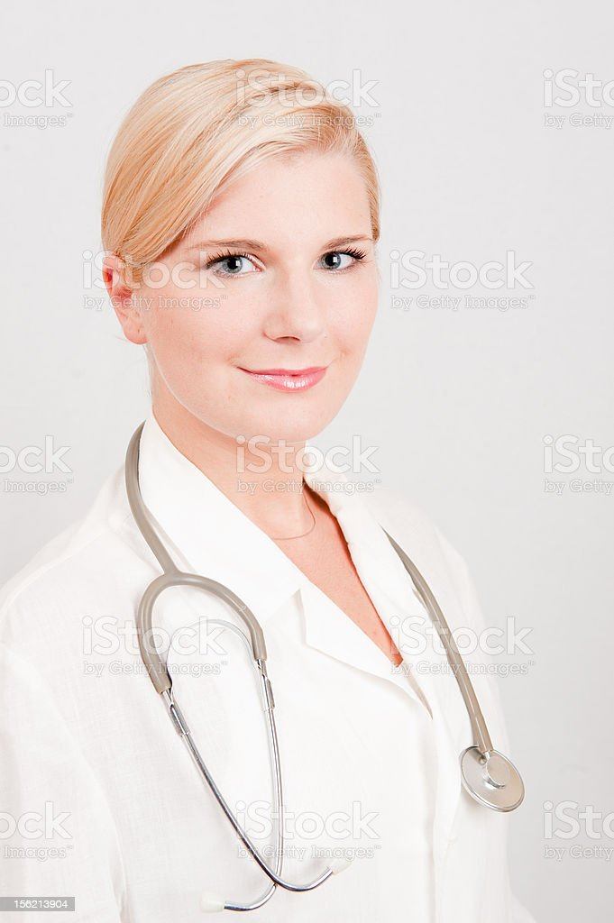 optimistic female doctor with a stethoscope royalty-free stock photo