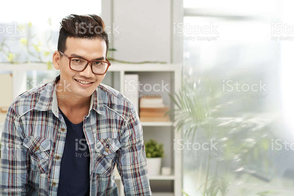 Optimistic guy stock photo