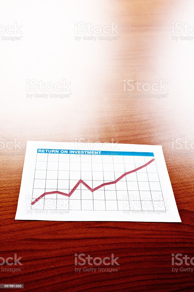 Optimistic, rising graph marked 'Return on Investment' stock photo