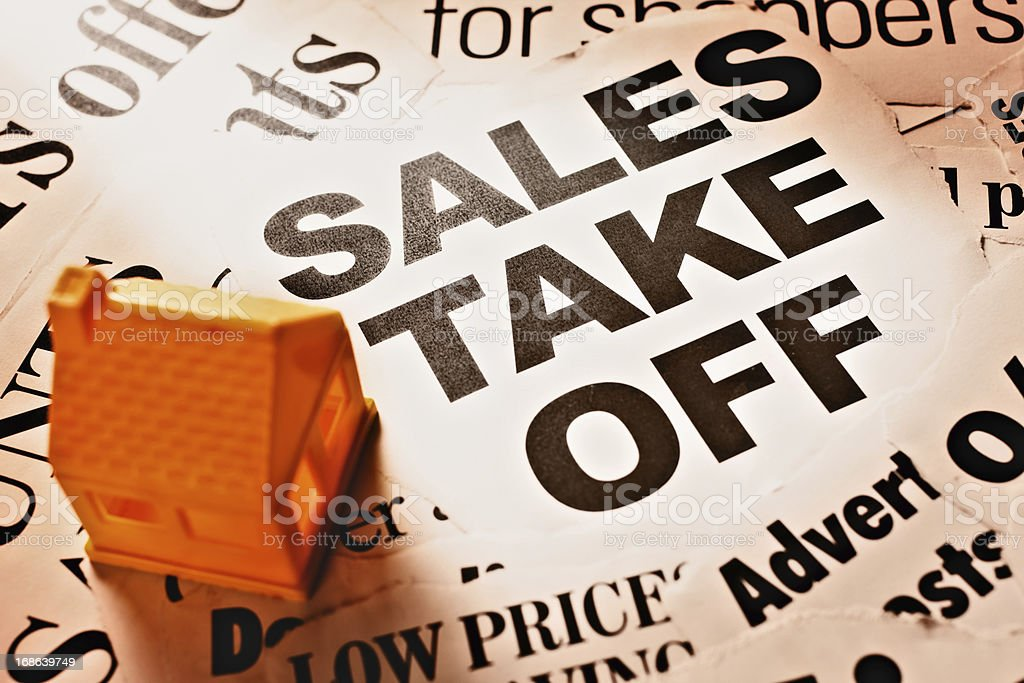 Optimistic sales headlines with toy house: good news for realtors royalty-free stock photo