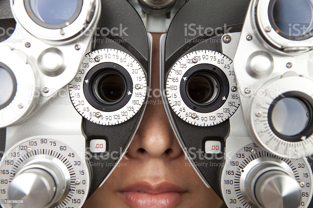 optometrist diopter with female (close up) stock photo