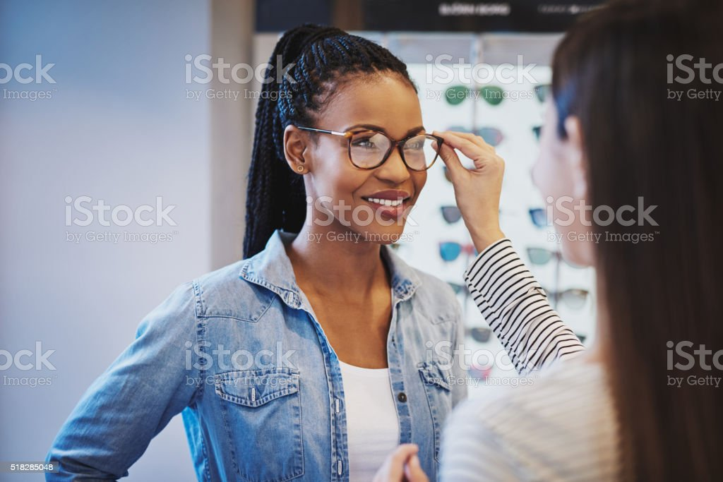 Optometrist fitting glasses on a customer stock photo