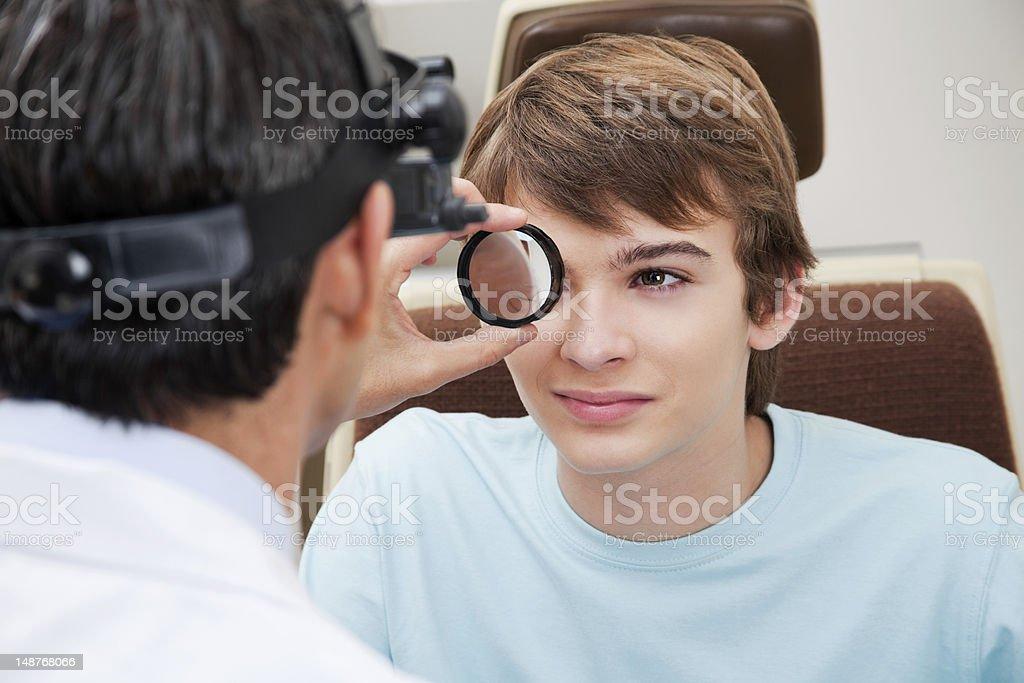 Optometrist performing Dilated Retinal Exam stock photo