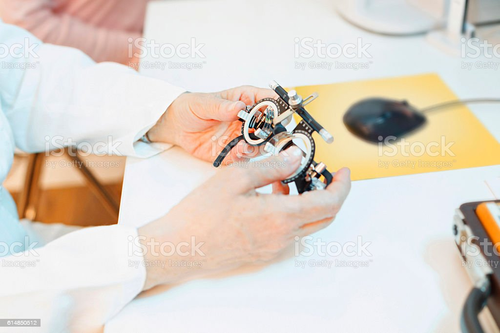 Optometrists eye test equipment   Eyeglasses and eye chart    Ophthalmology stock photo