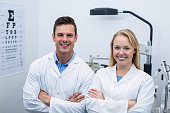 Optometrists standing in ophthalmology clinic
