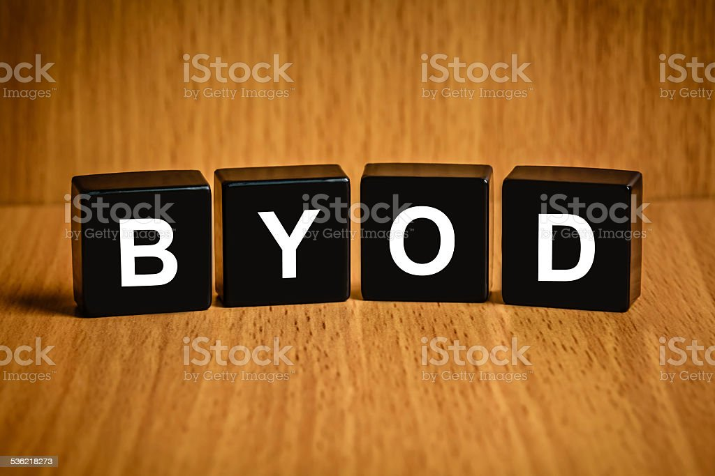 BYOD or Bring your own device word on black block stock photo