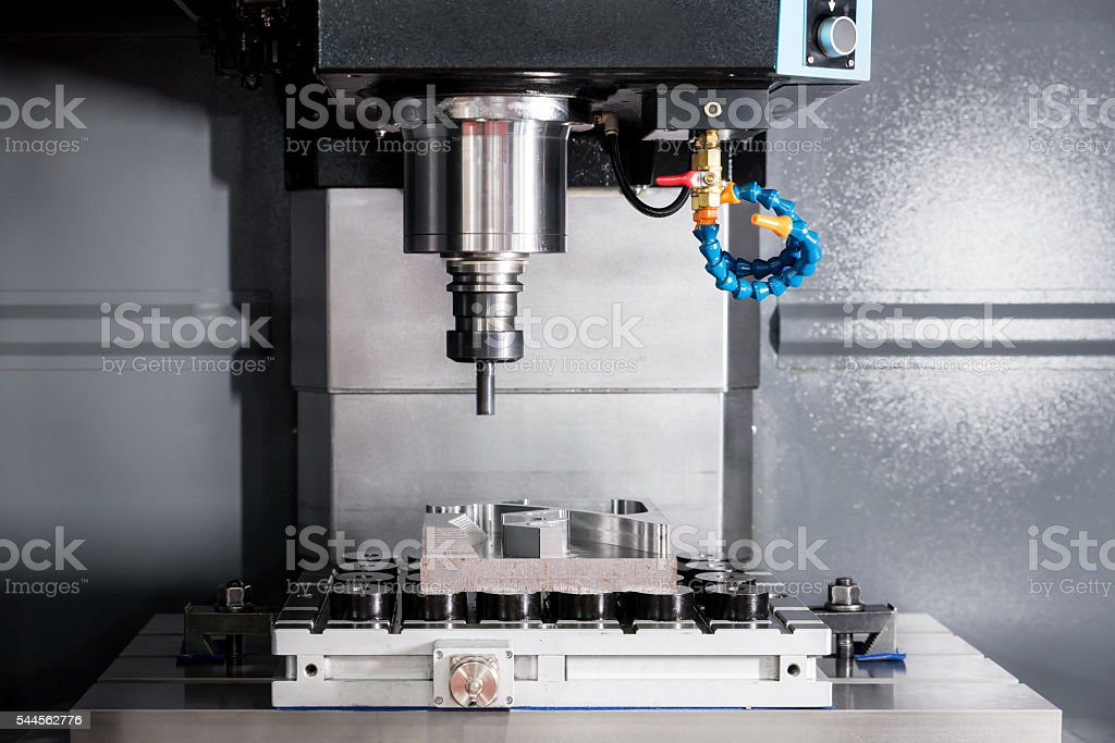 EDM or CNC industry machine working with coolant injection stock photo