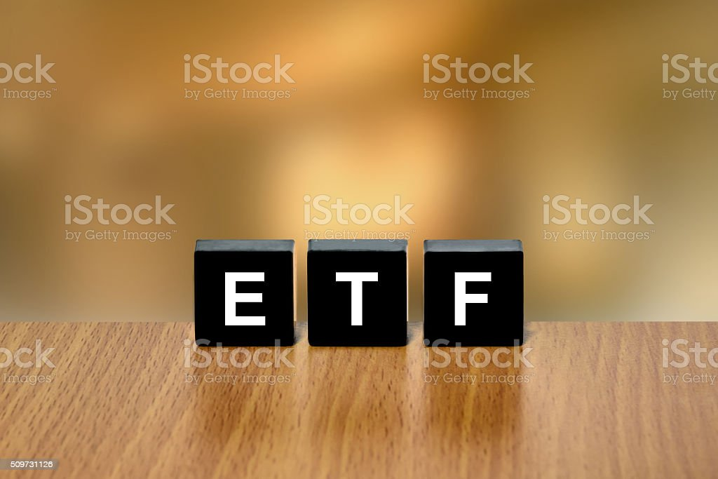 ETF or exchange traded fund on black block stock photo