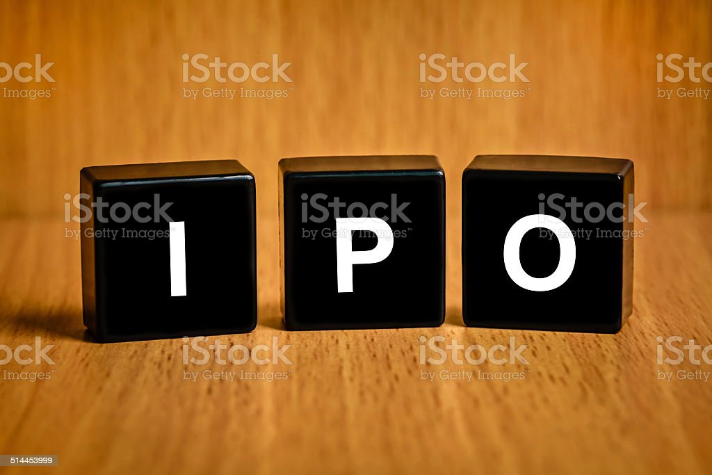 IPO or Initial public offering word on black block stock photo