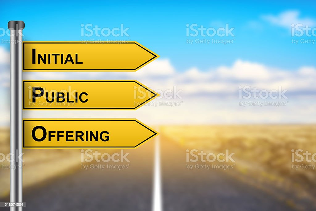 IPO or Initial public offering words on yellow road sign stock photo