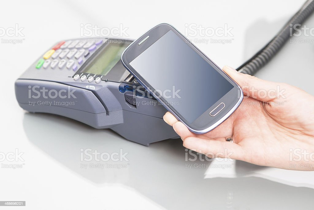 NFC or near field connection from mobile to EFTPOS machine stock photo