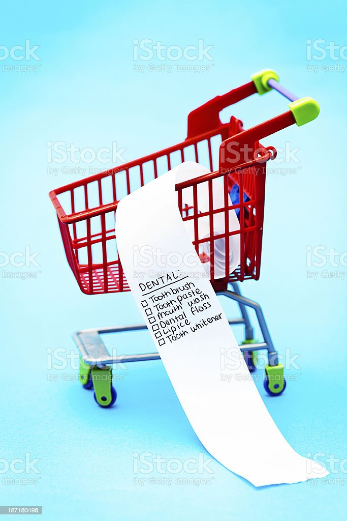 Oral hygiene shopping list in tiny trolley stock photo
