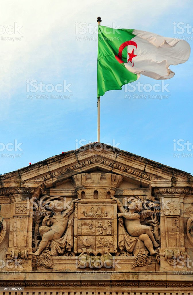 Oran, Algeria: coat of arms and flag stock photo