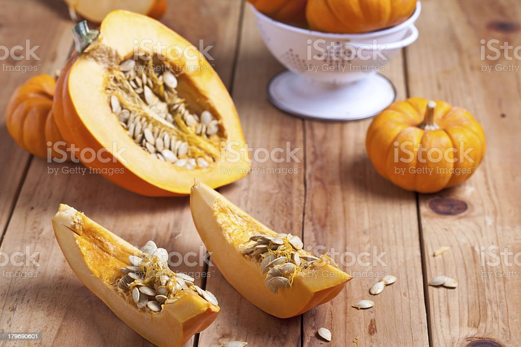 Orange Acorn Squash and Baby Pumpkins on wooden surface. royalty-free stock photo