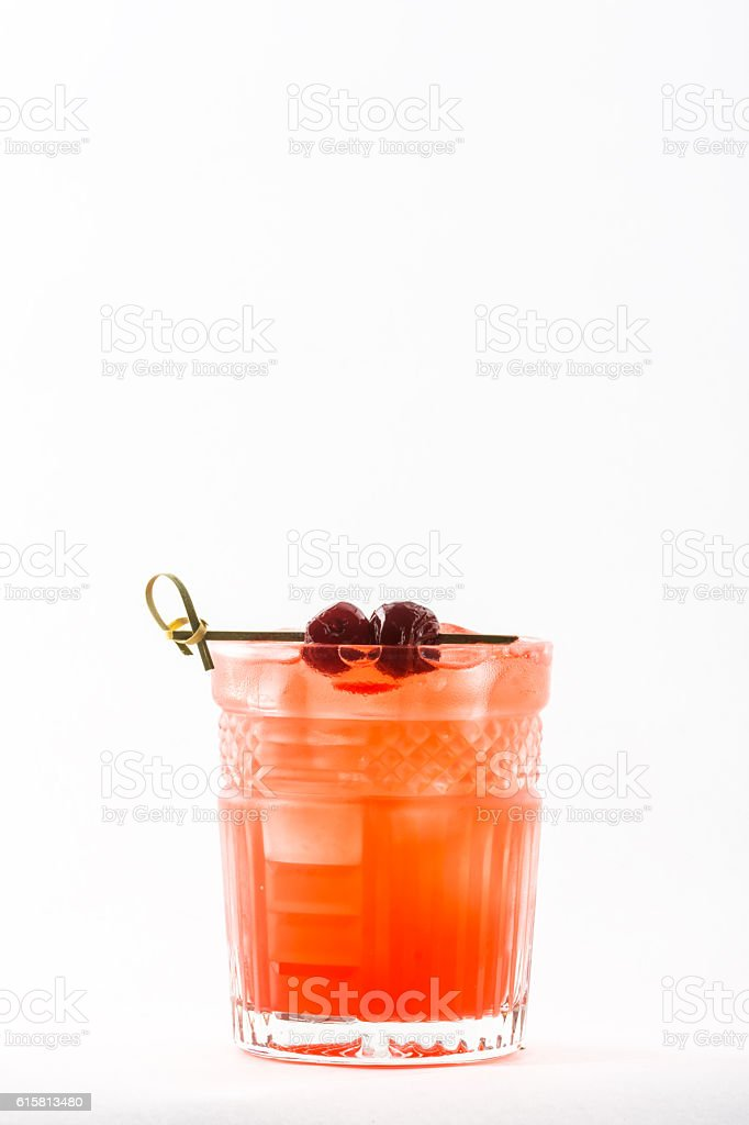 Orange alcohol cocktail with berries stock photo
