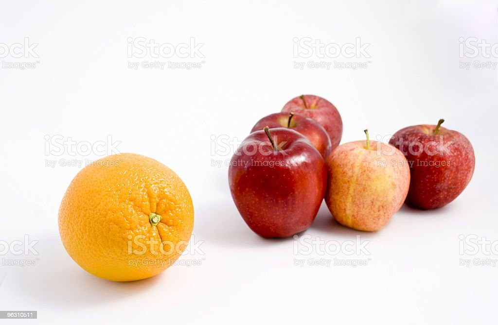 Orange among Apples royalty-free stock photo