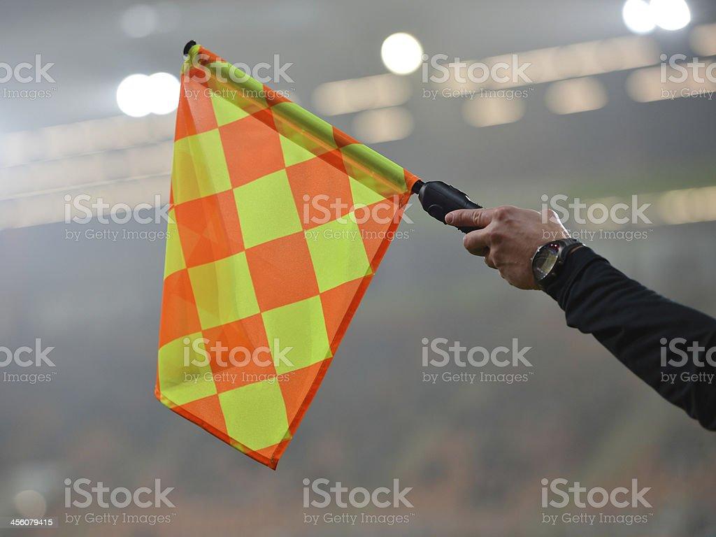 A orange an yellow checkered flag stock photo