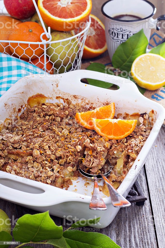 Orange and apple crumble with oats stock photo