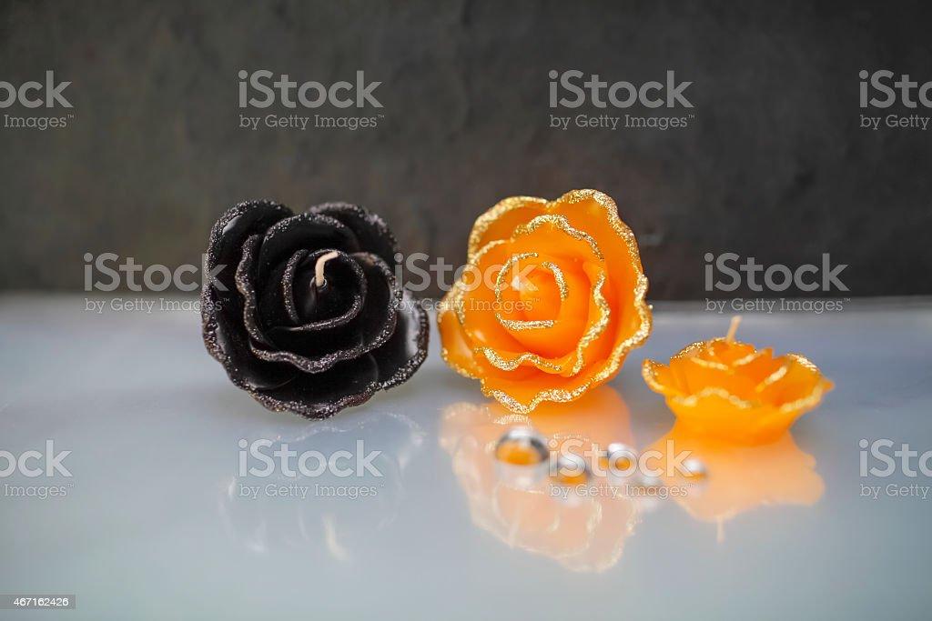 Orange and black rose candle royalty-free stock photo