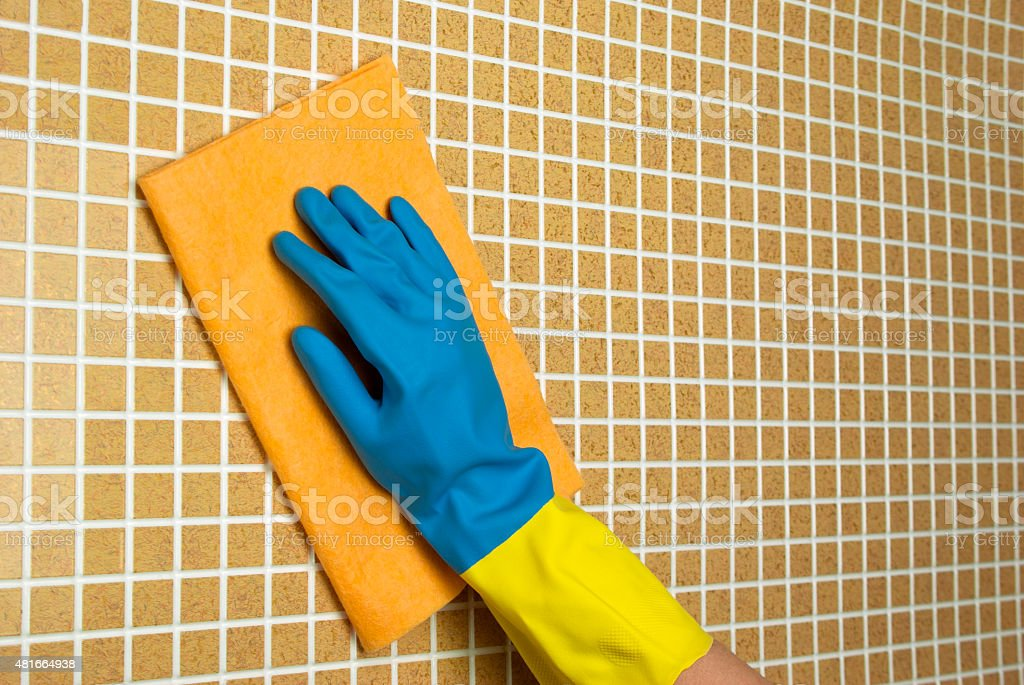 orange and blue cloth with yellow glove royalty-free stock photo