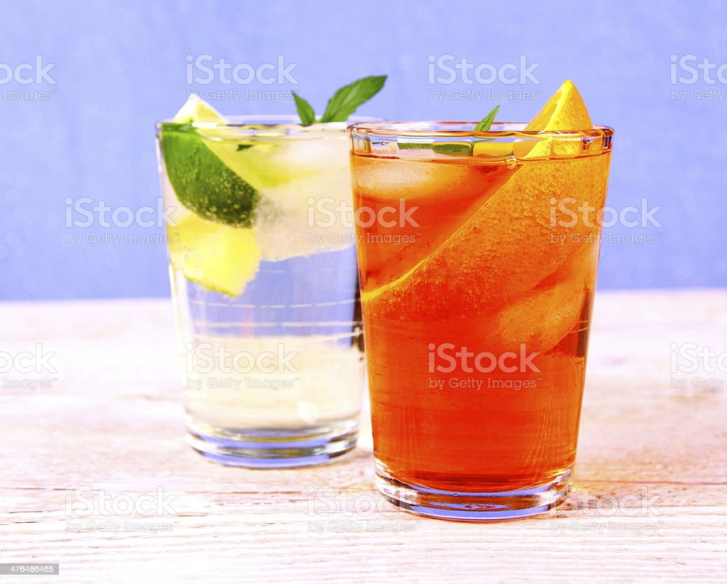 Orange and elderflower cocktails on blue background stock photo