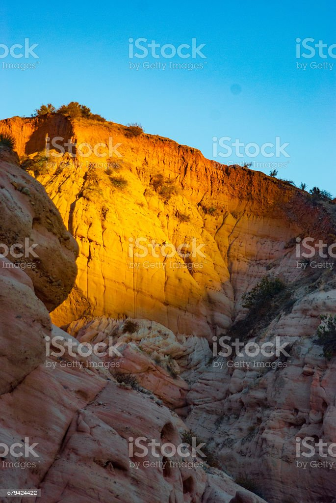orange and golden highlighted cliff face stock photo