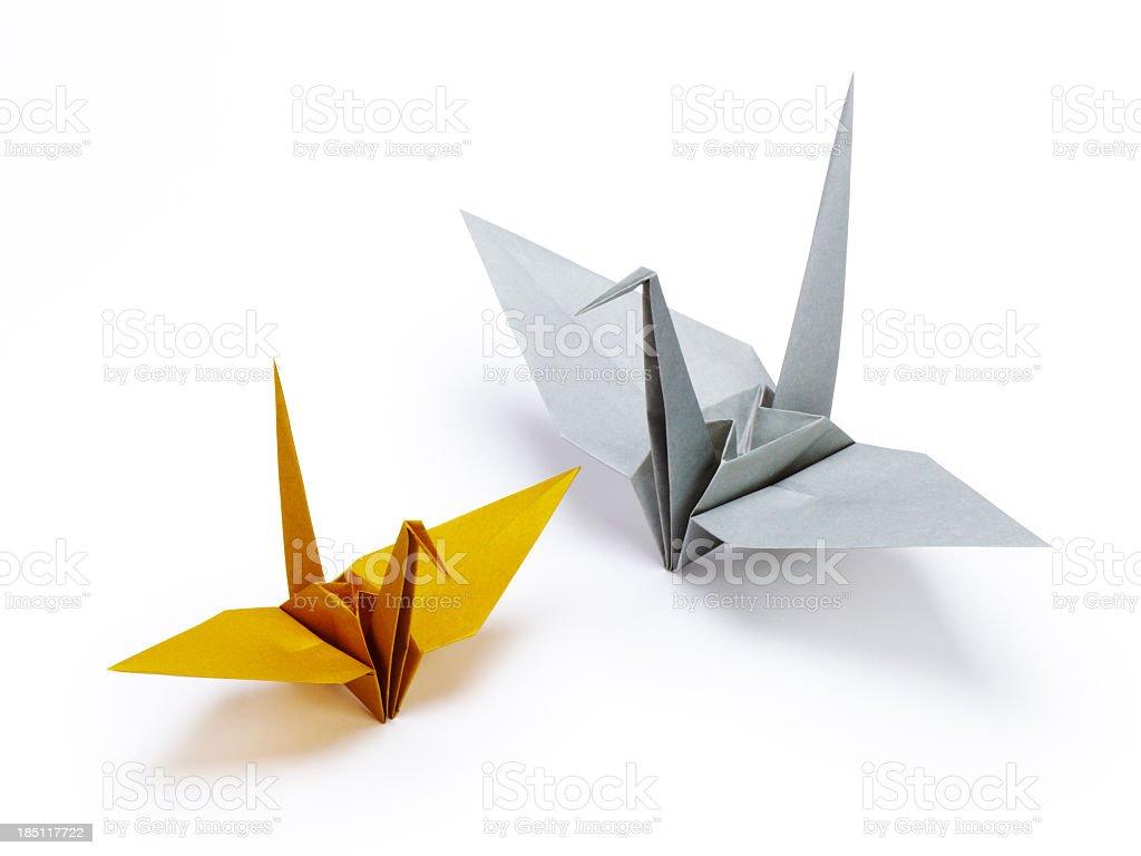 Orange and gray origami cranes stock photo