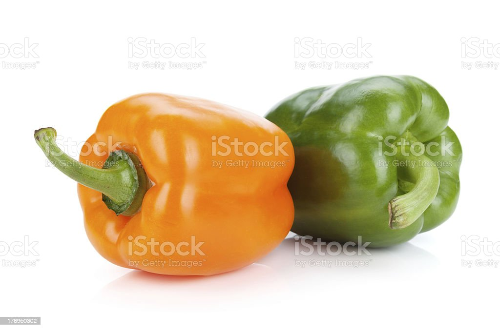 Orange and green bell peppers royalty-free stock photo