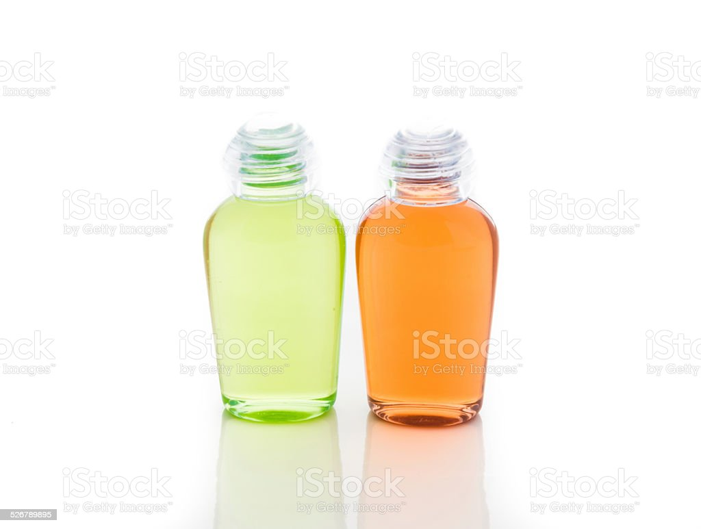 Orange and green bottle of shampoo, gel, soap stock photo