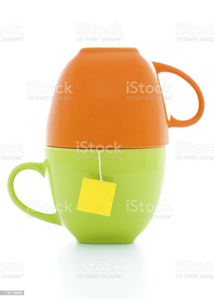 orange and green cups with tea bag royalty-free stock photo
