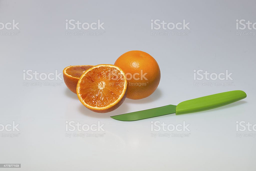 Orange and Knife royalty-free stock photo