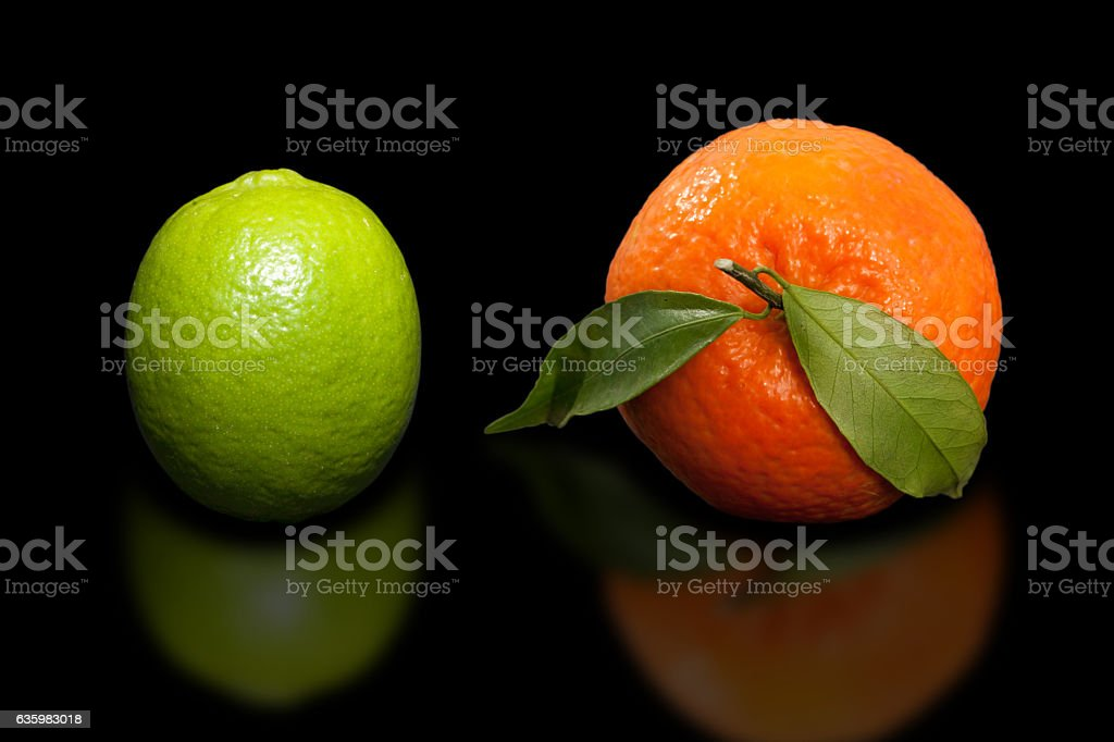 Orange and lime on black background. stock photo