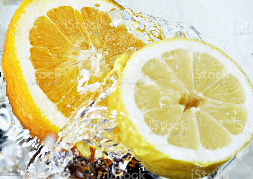 orange and lime splashing stock photo
