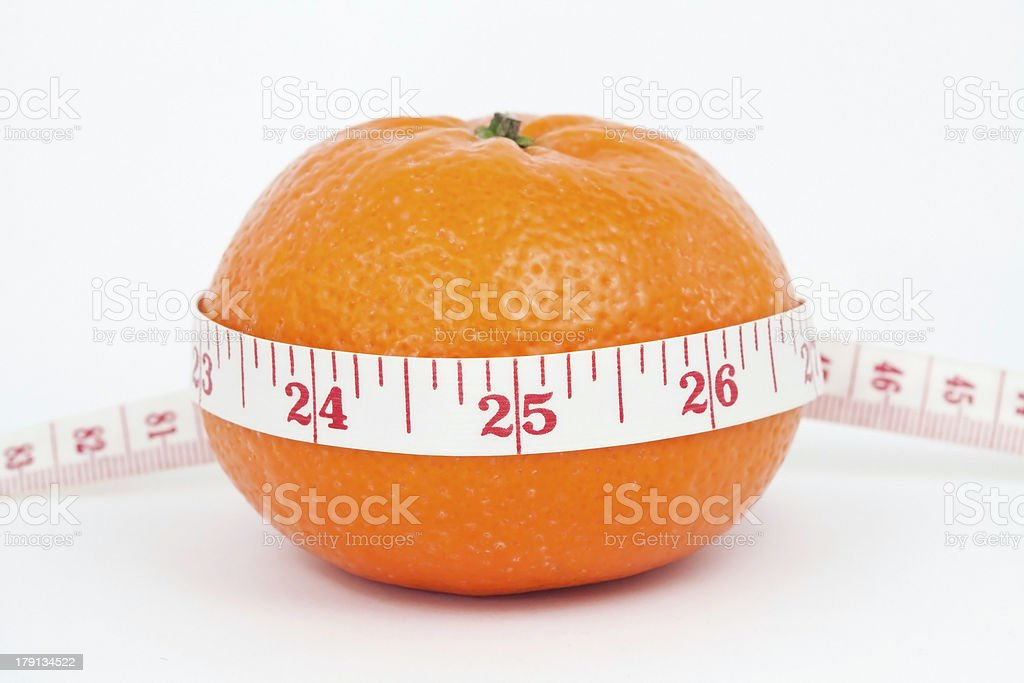 Orange and measuring tape royalty-free stock photo