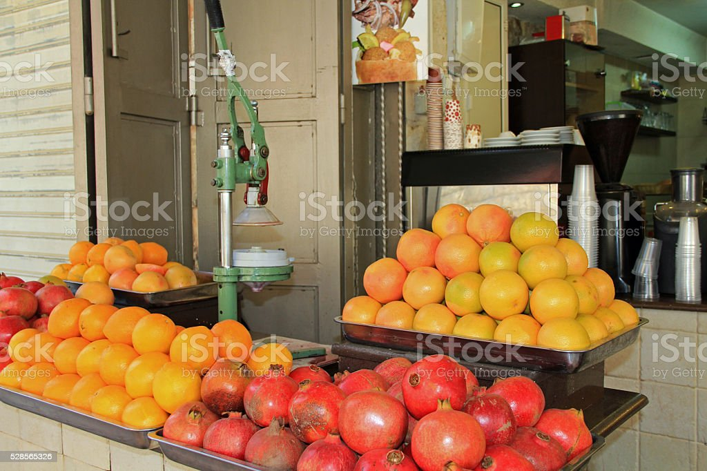 Orange and Pomegranate drink stand in an Israeli Market stock photo