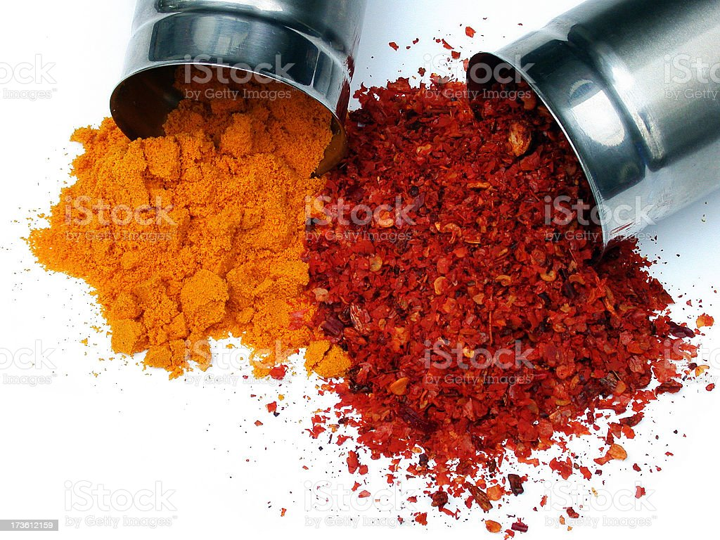Orange and red spice powder shed on white background stock photo