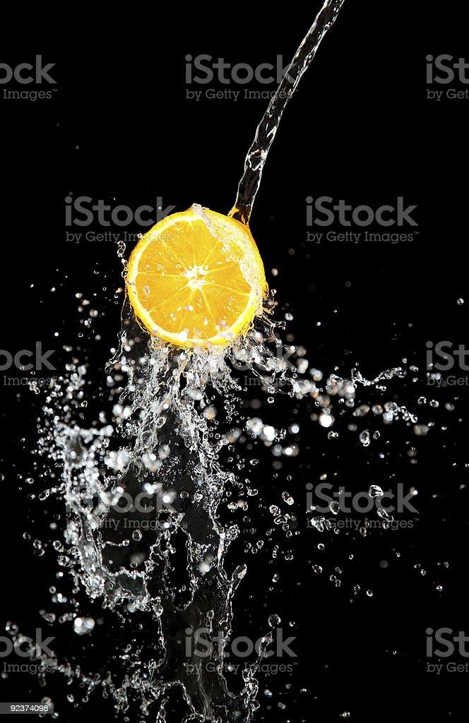 orange and waters splashes royalty-free stock photo