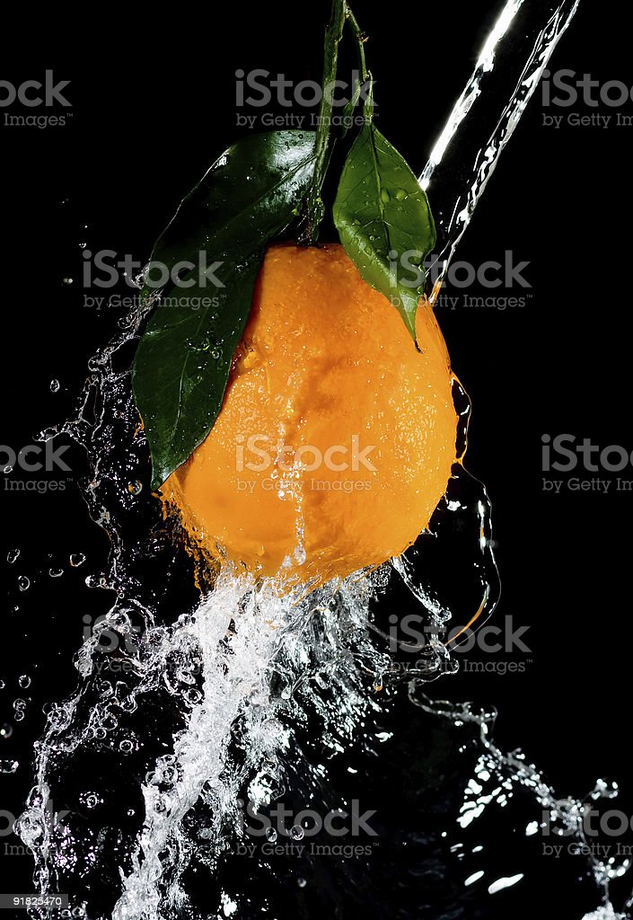 orange and waters splashes three royalty-free stock photo